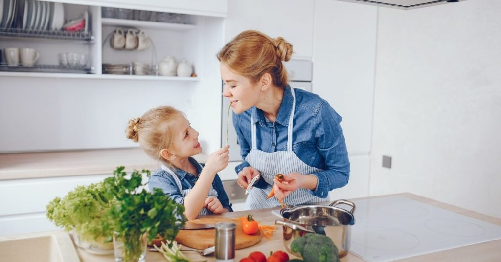 mother and daughter cooking healthy food