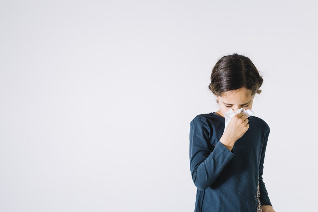 girl-blowing-nose